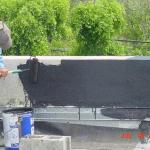 APPLYING PRIMER BASE TO PARAPET WALL